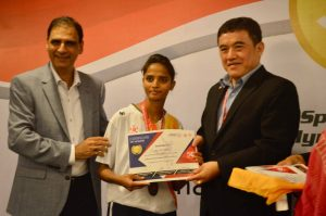 Chairman Kartikay Saini presenting certificates to coaches during Special Olympics Conference