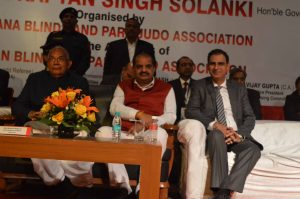 Dr Kartikay Saini with Honourable Governor of Punja and Haryana Prof Kaptan Singh Solanki
